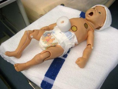 this is a  baby medical dummie being taking care of.